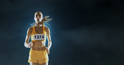 Track and field runner on the dark foggy backgound. Athlete wears unbranded clothes. Arena and people on it are made in 3D.