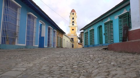 Low angle steadicam shot of quiet streets of historic colonial Trinidad town in Cuba