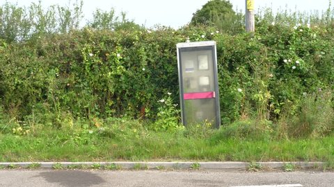 old abandoned phonebox by the side of the road, UK