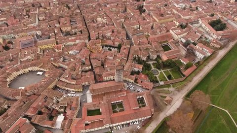 Aerial shot, beautiful panorama of Lucca city, an ancient town in the middle of Tuscany, Italy,  4K