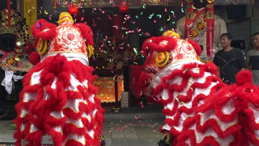 Taipei, Taiwan-30 May, 2017: Slow motion Taiwanese lion dance front a Matsu temple fair of township in Taiwan festivals Gods. Procession with acrobatics red lions dancing in street of Taipei city-Dan