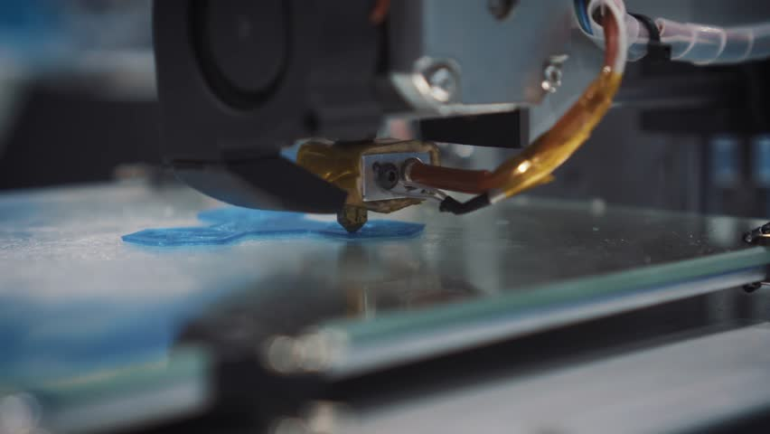 Three dimensional printer during work in school laboratory, 3D plastic printer, 3D printing.   Shutterstock HD Video #29543587
