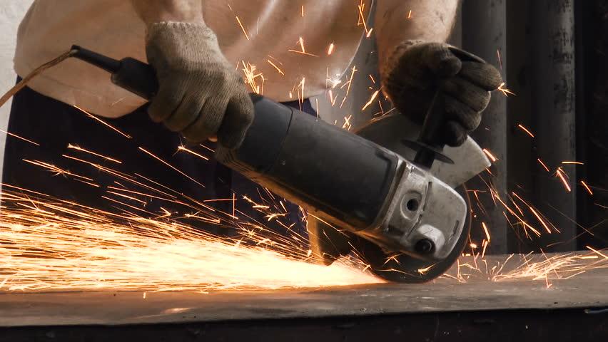 Metal grinding on steel pipe close up stock footage video