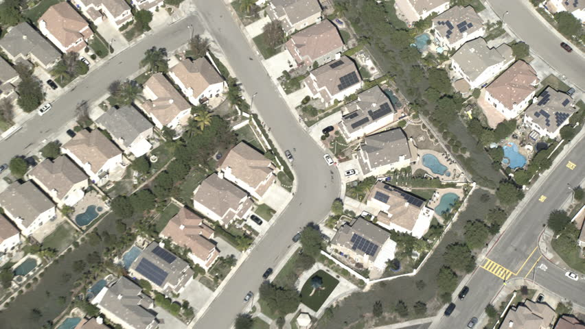 Day aerial pull back nice suburban houses swimming pools wide residential cookie cutter neighborhood, | Shutterstock HD Video #29546677