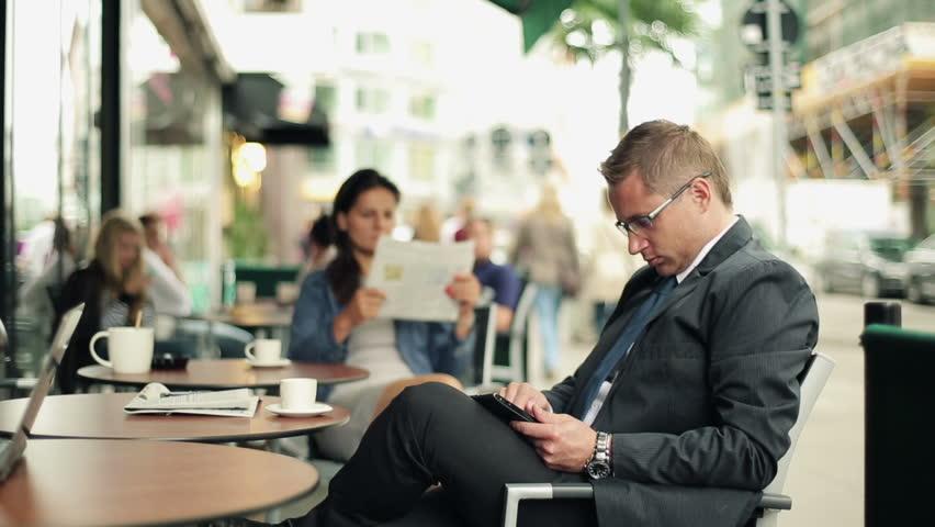 Businessman working on tablet computer in cafe, steadicam shot  | Shutterstock HD Video #2955367