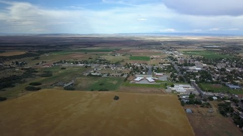 MONTICELLO, UTAH - 24 JUL 2017: Aerial Monticello Utah rural city pan. Rural community southern Utah, San Juan County. High mountain plateau, dry farm landscape. Agriculture economy. Small town.