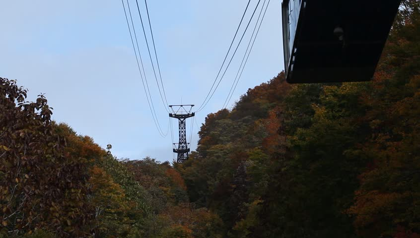 AOMORI, JAPAN - OCT 25: Gondola of Hakkoda ropeway climbing up to the summit of Mt.Hakkoda on October 25, 2012 in Aomori prefecture, Japan. This ropeway offering view of crimson foliage in autumn.