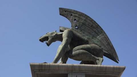 valencia spain 07-19- 2017   A mythical gryphon statue  from  Valencia city in   Spain - Four statues guard a bridge in the middle of valencia city