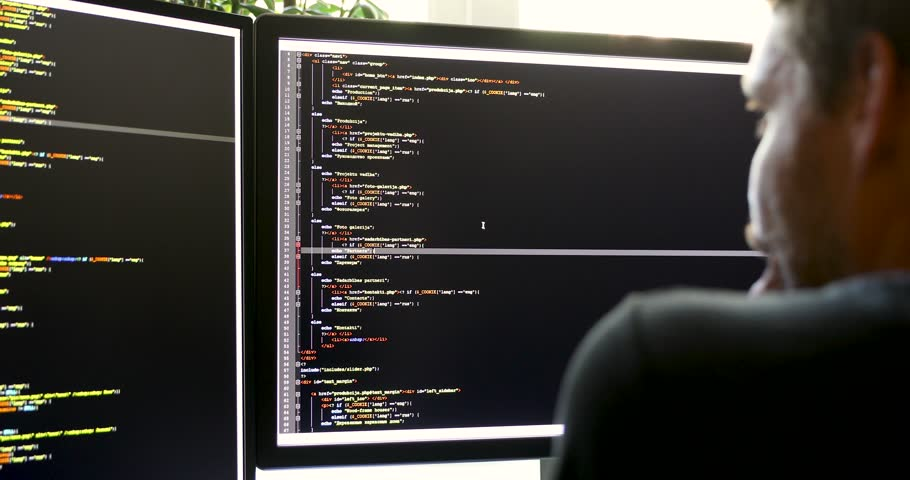 Programmer working in office writing programming code (there is no possible trademark or copyright infringement with programming code)   Shutterstock HD Video #29630818
