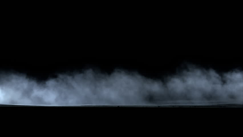 Side view of dust trail behind car isolated on black background, with alpha matte.