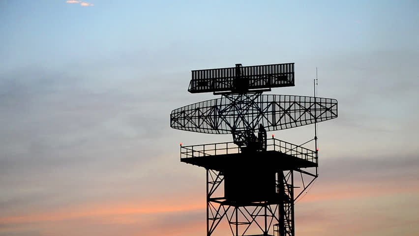 silhouette radar tower and plane