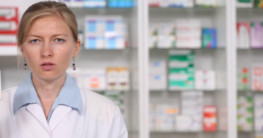 Pan Left Of Close Up Of Confident Medical Woman Looking Camera, Speech Pills Box Info | Shutterstock HD Video #29728267