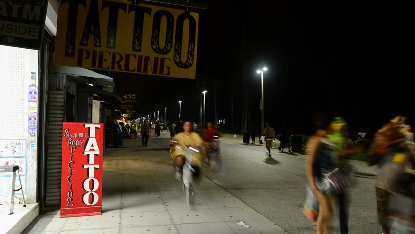 VENICE, CA - CIRCA OCTOBER 2012: Time lapse of pedestrians on the boardwalk circa October 2012 in Venice, CA.