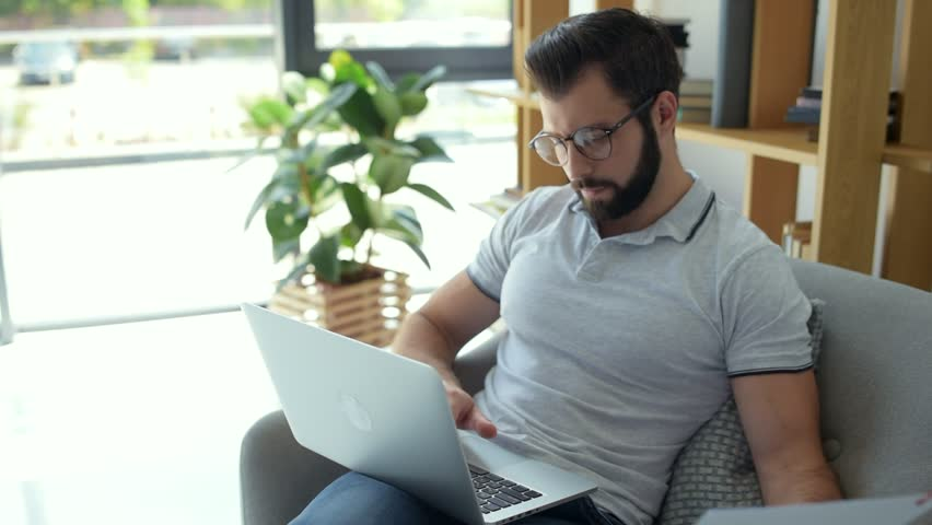 Handsome freelancer enjoying working from home | Shutterstock HD Video #29756017