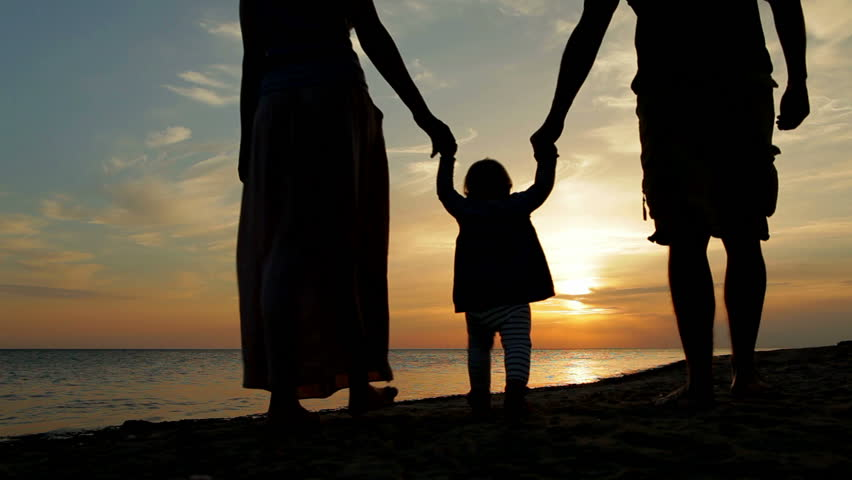Happy family walking on sea coast. Silhouettes sunset. | Shutterstock Video #2980051