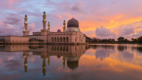 Time lapse of sunset and scattered clouds at a mosque in Likas, Kota Kinabalu, Sabah, Malaysia. 4K resolution, 3840 x 2160. Tilt Down Motion Timelapse.