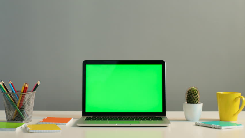 close up shot view of laptop with green screen on the modern office table with decoration