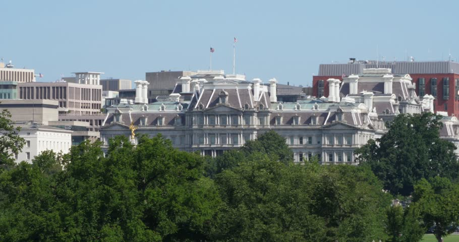 A long daytime establishing shot of the Dwight D. Eisenhower Executive Office Building on Pennsylvania Avenue next to The White House in Washington, D.C.