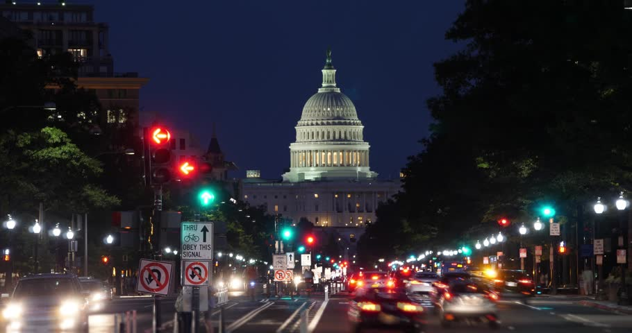 A night time lapse view of traffic activity on Pennsylvania Avenue in Washington, D.C. with the Capitol Dome in the distance.