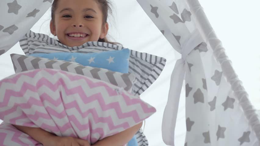 Joyful little girl holding pillows | Shutterstock HD Video #29882497