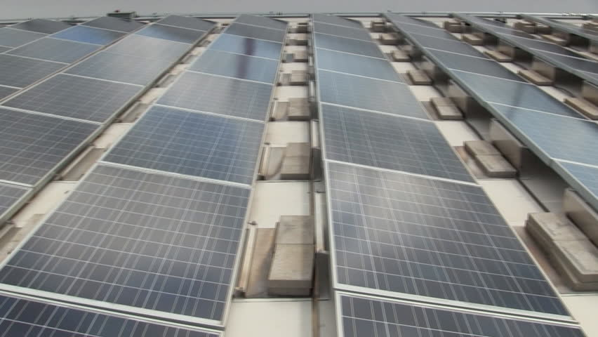 Array of solar panels on roof of electronic manufacturing building on Cape Cod provide clean energy for facility.  Pan from right to left  | Shutterstock HD Video #2994937