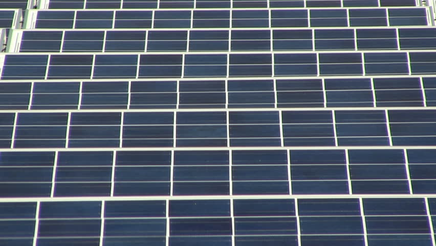 HD 1080 24p; Zoom out of rooftop solar panel grid at electronics company on Cape Cod