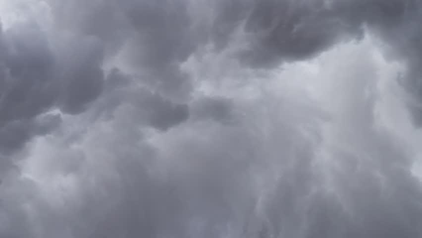 Billowing clouds of steam swirling across sky slow motion