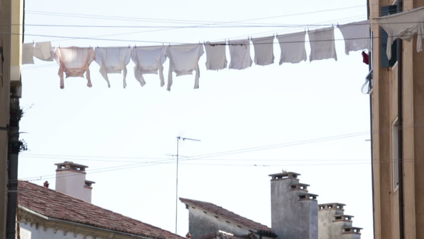 White clothes hanging on a rope drying in Venice