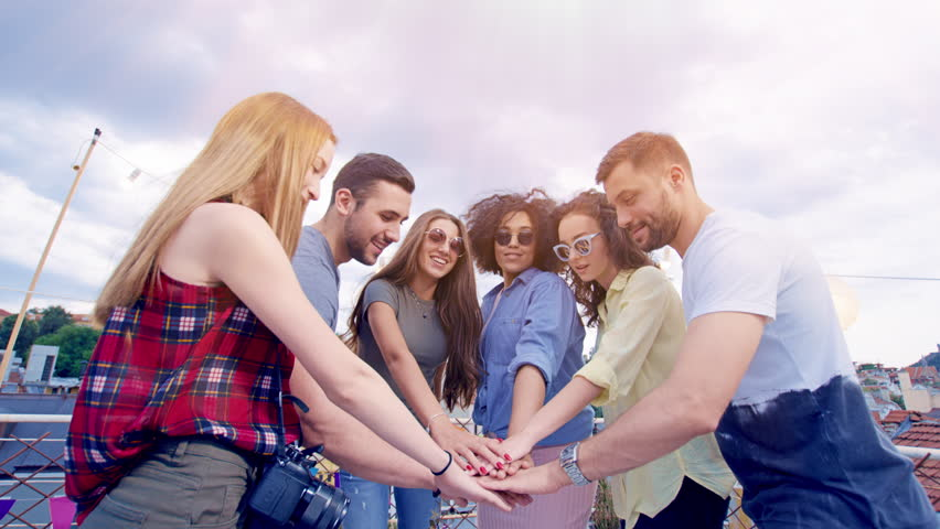 Diverse Group Of Young Hipsters Friends On Rooftop Standing In Circle Raising Hands Celebrating Successful Teamwork Success And Colaboration Fun Time At Party Carefree Friendship Cheerful Artsy   Shutterstock HD Video #30008377