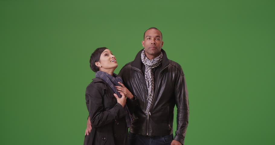 A black man and woman act playfully on green screen. On green screen to be keyed or composited. #30022267