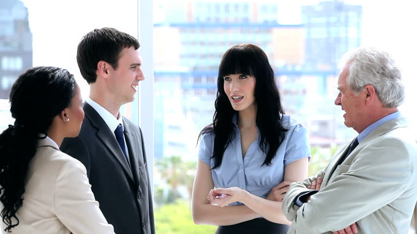 Business people standing white talking together in a bright room | Shutterstock HD Video #3003052
