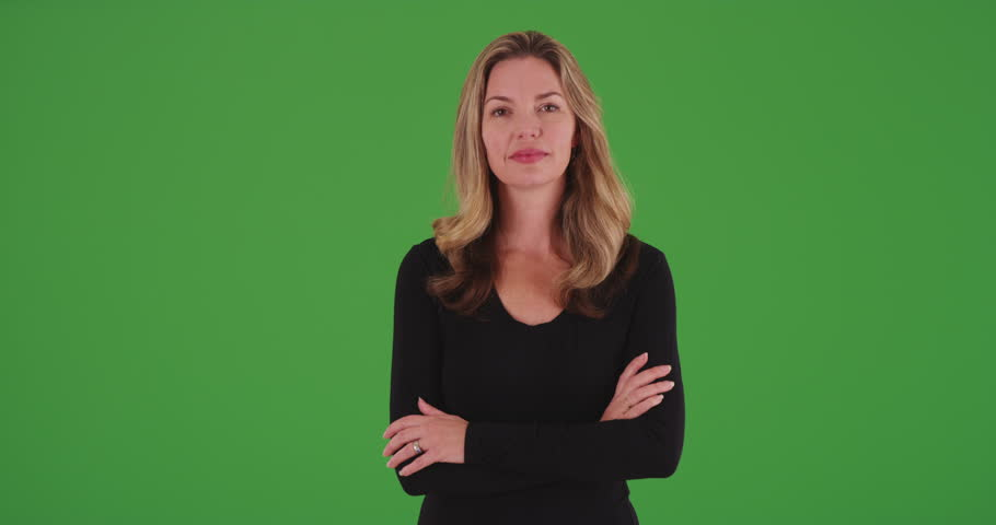 Attractive blonde female smiling at camera with arms crossed on green screen. On green screen to be keyed or composited. #30032437