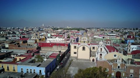 4K Video of morning rotating right aerial view cityscape of Cholula, Mexico
