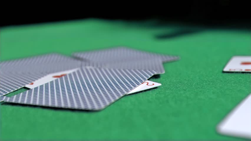 Playing card in super slow motion being thrown on a poker table - HD stock  video