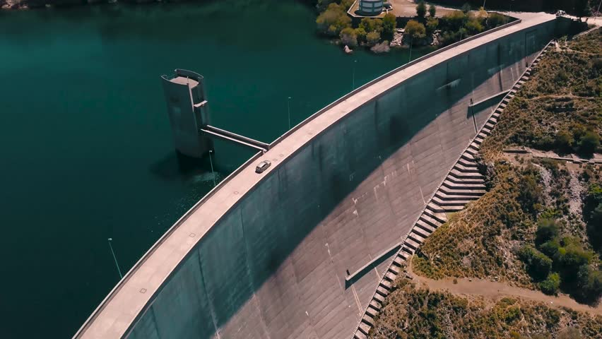 Car Rides on Highway Road Cinematic Drone Footage Aerial Shot of a Car Riding Away From Camera on a Dam in Peneda Geres National Park Portugal, Europe  4K