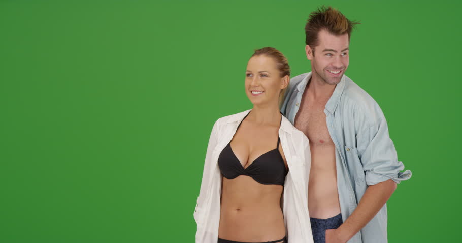 Beautiful millennial couple enjoying their vacation on green screen. On green screen to be keyed or composited.