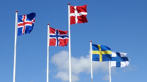 scandinavian flags from norway, sweden, finland, iceland, denmark blowing in the wind