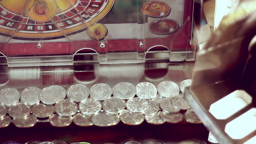 Coins moving inside gambling machine in amusement park | Shutterstock HD Video #3010777