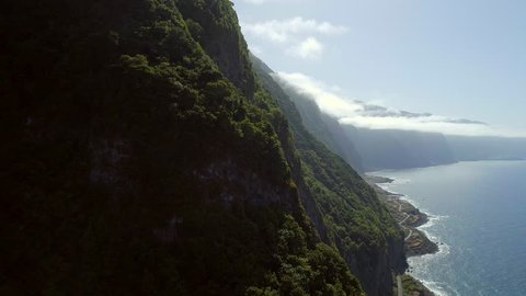 Aerial View of the Lush Green Forest Coastline of Madeira in the Late Afternoon