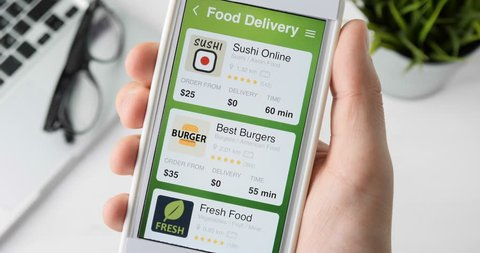 Ordering pizza using food delivery app on the smartphone