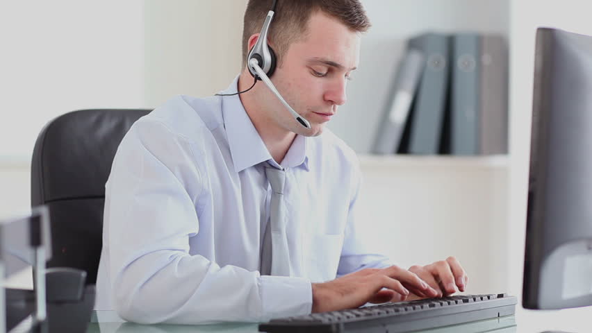 Man having a conversation with a headset in a office