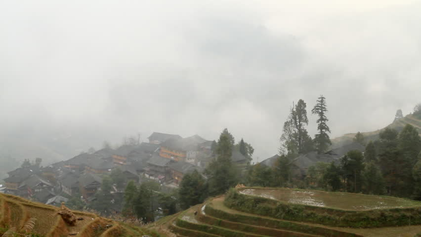 Village and Terraced Rice Field in the Fog - Longsheng, Guangxi province, China.