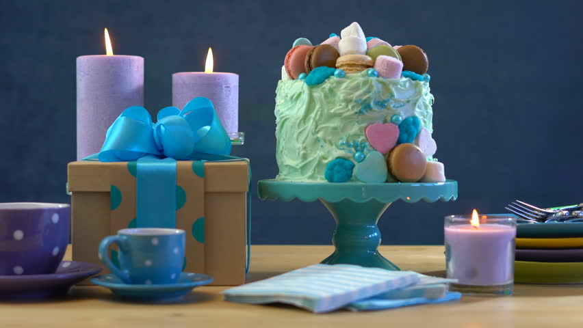 Blue Theme Birthday Party Table Celebration Showstopper Cake Decorated With Candy Marshmallows And Macarons Cookies Static
