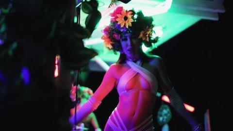 Beautiful girl is dancing. Disco. Night club. Ibiza. Openair. Holidays. A party. Night dance.