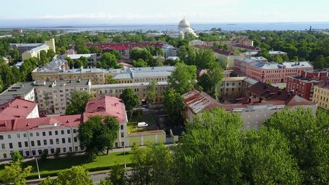 4K aerial video footage view of Kronstadt town center, park, war vessels and boats and view of navy military base near St. Petersburg 700 km from Moscow, Russia on clear summer morning