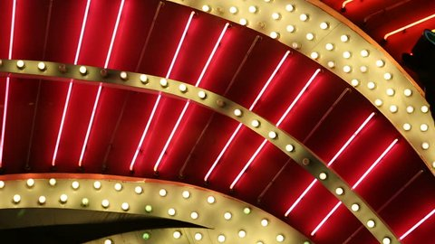 Red Neon Tube Lights and Bulbs Blink Detail. detail of a Las Vegas Casino neon lights and blinking bulbs