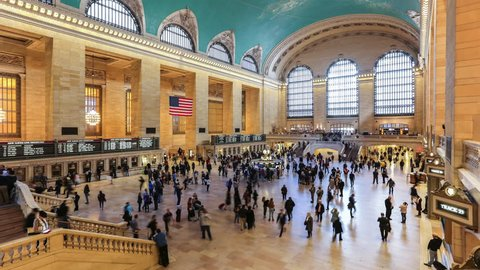 NEW YORK CITY - OCTOBER 14, 2016 : Passengers traveling through Grand Central Station October 14, 2016 in New York City, NY. Time lapse of the interior of Grand Central Station in New York.