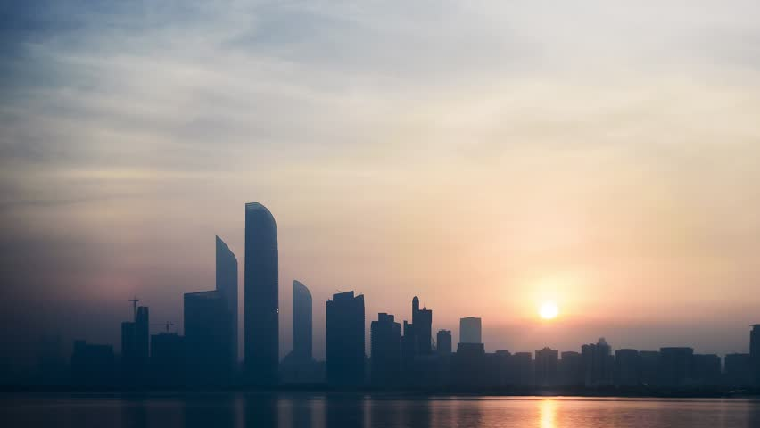 Abu Dhabi, United Arab Emirates - August 2017 - Sunrise over the Abu Dhabi Skyline