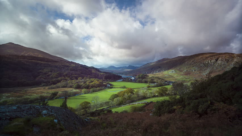 Timelapse of Welsh valley in the Fall with clouds, shadows and sunshine moving towards the camera, Wales
