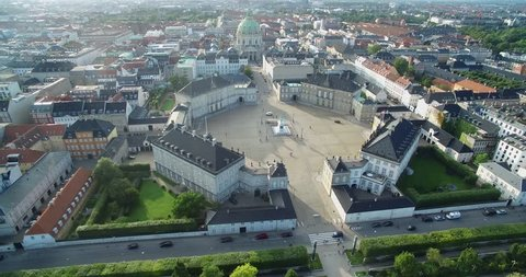 Amalienborg, home of the Danish royal family winter residence and Frederik's Church in background with Copenhagen Cityscape. Nyhavn in backgound
